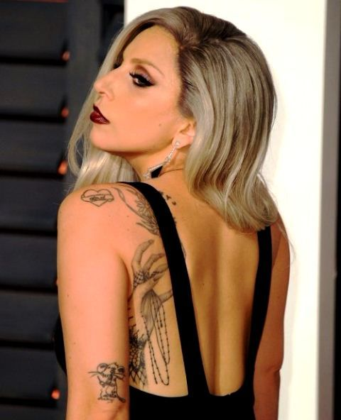 Lady Gaga's Mouse tattoo on her left elbow